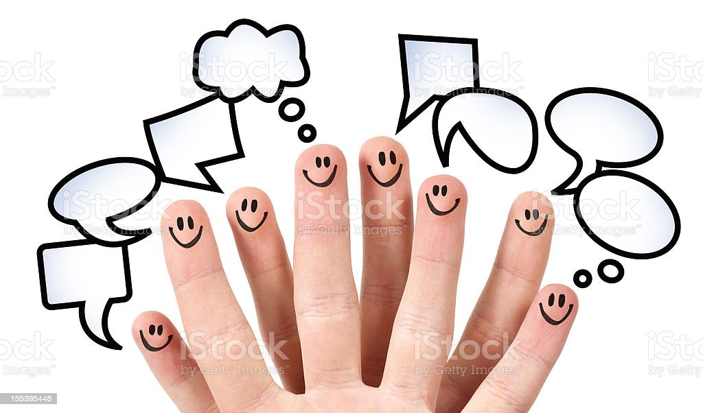 Eight fingers with smiley faces and speech bubbles stock photo