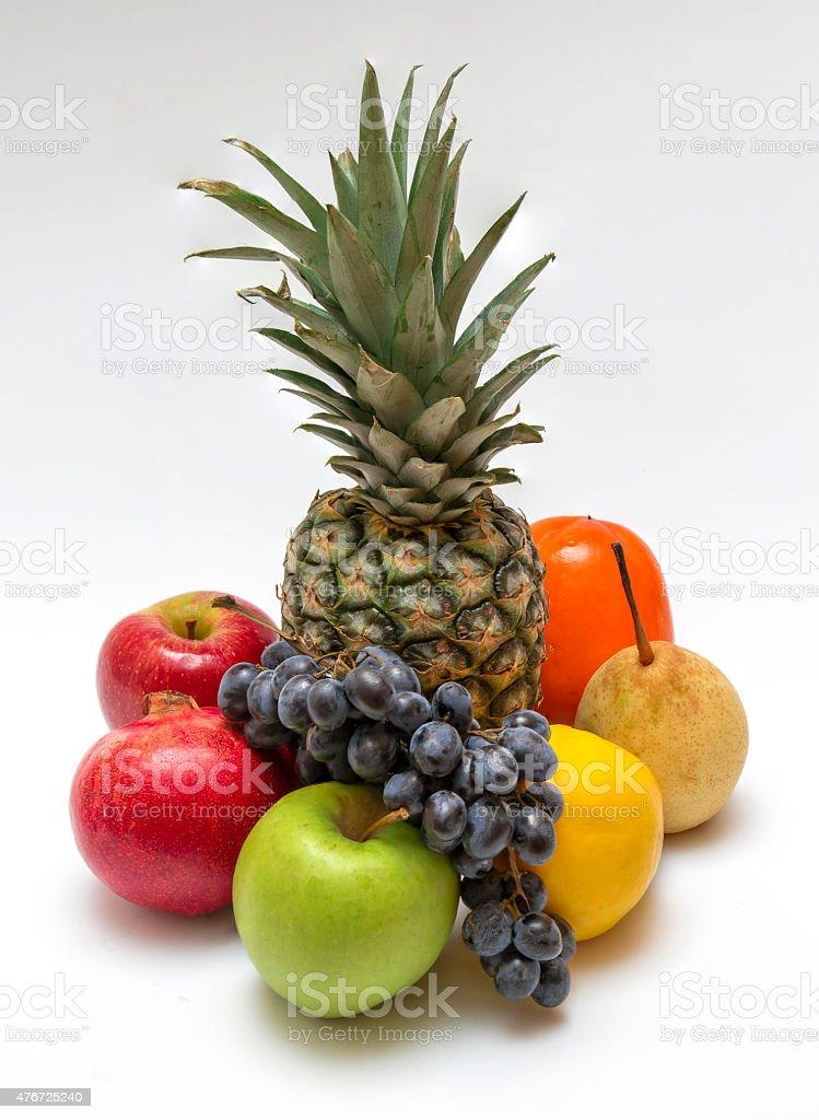 Восемь фрукты на белом столе стоковое фото