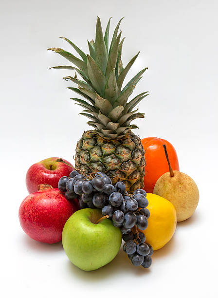 Cтоковое фото Восемь фрукты на белом столе