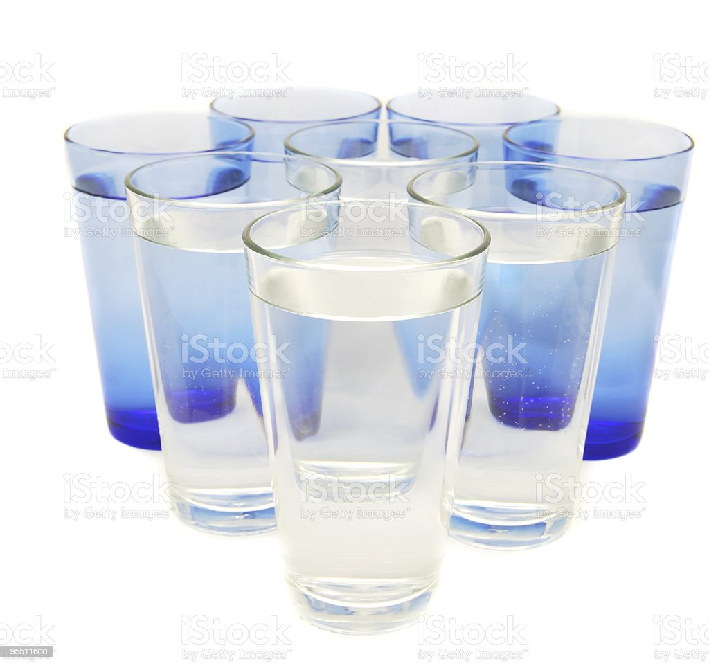 Eight glasses of water stock photo