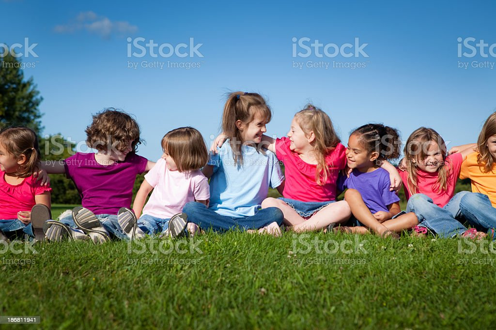 Eight Happy Little Girls Sitting and Hugging One Another royalty-free stock photo