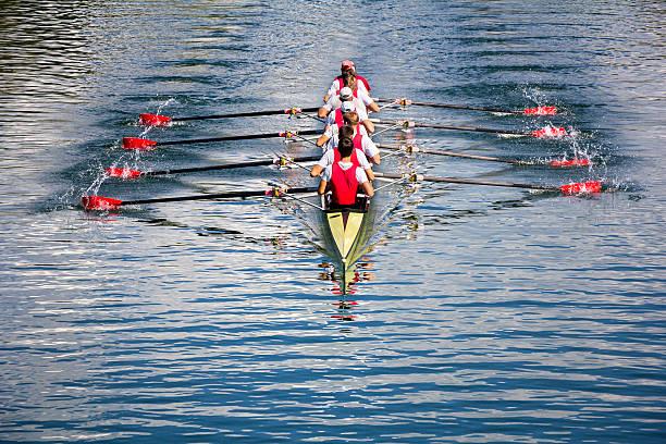Eight men rowing stock photo