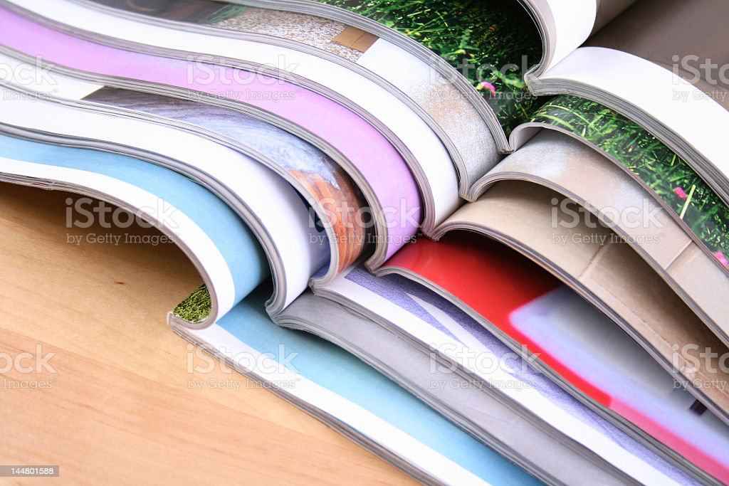 Eight open magazines on top of each other stock photo