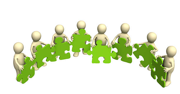 Eight puppets, holding in hands a puzzle of green color stock photo