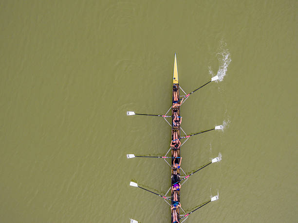 Eight rowing team boat aerial view stock photo