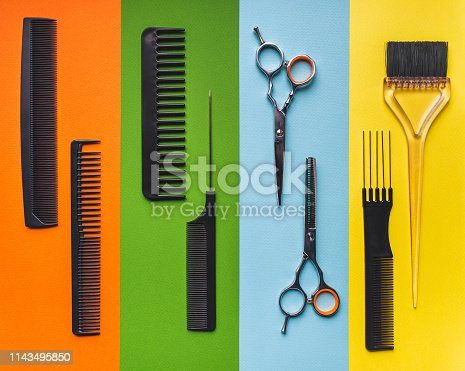 696318954 istock photo Eight tools hairdresser on the background of pastel paper in the form of multi-colored stripes. Barbershop. 1143495850
