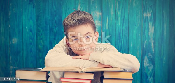 683105722 istock photo eight years old child reading a book 907990718