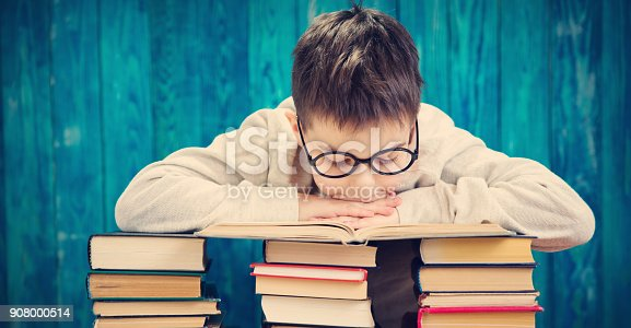 683105722 istock photo eight years old child reading a book 908000514