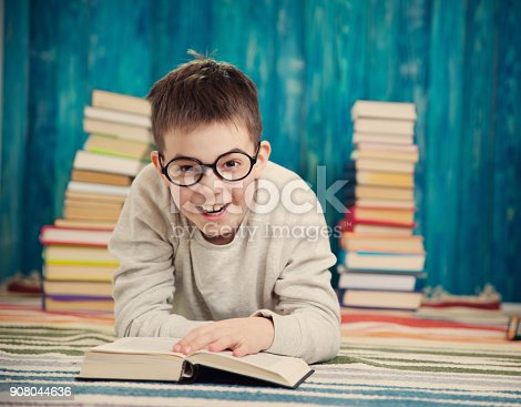 683105722 istock photo eight years old child reading a book 908044636