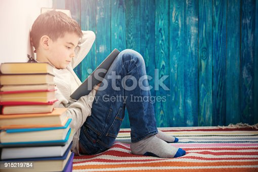 istock eight years old child reading a book 915219784