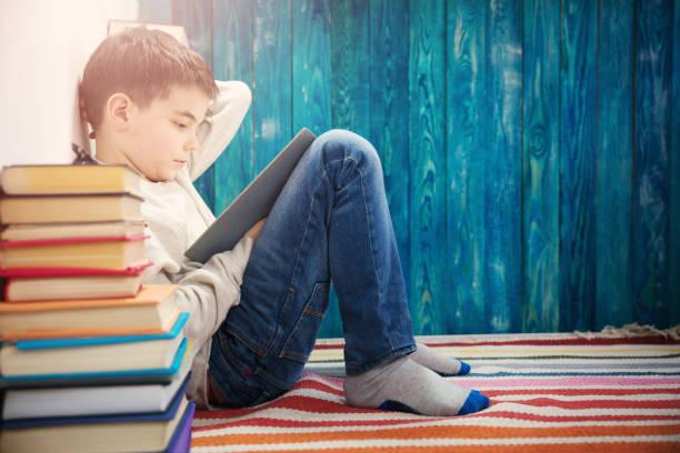 Eight years old child reading a book picture id915219784?b=1&k=6&m=915219784&s=612x612&w=0&h=wurdx 25ewqhug1p79krzoubu5 idurb8lickua8lj4=