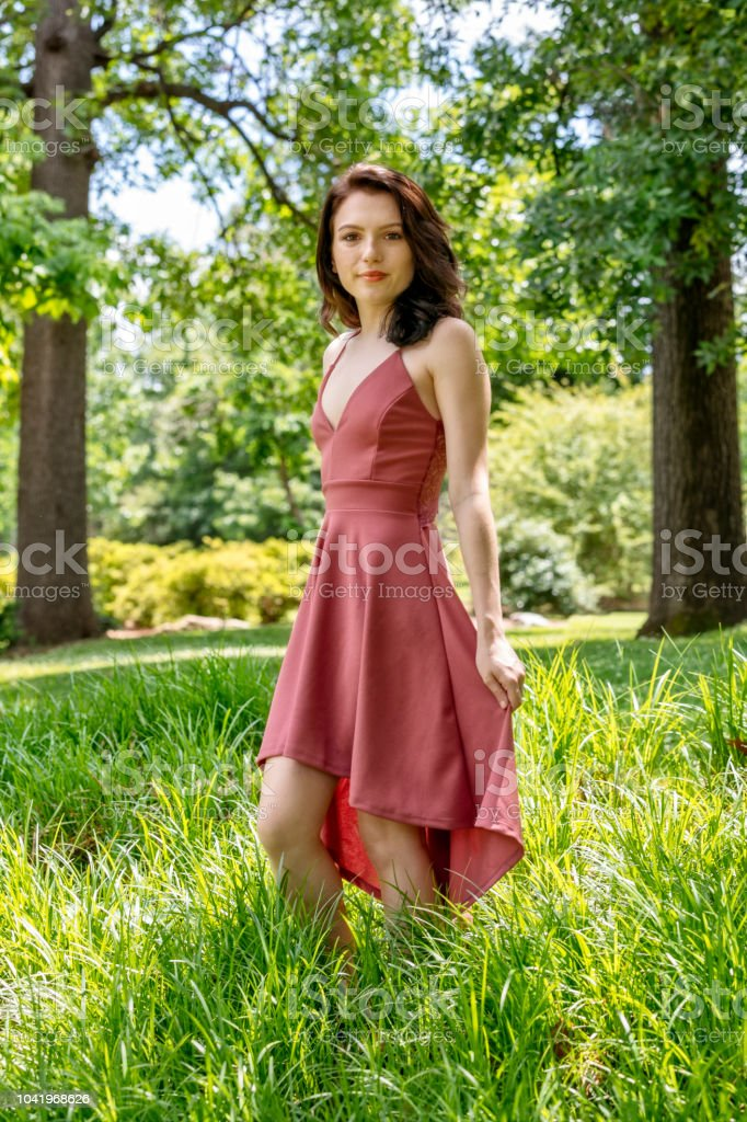 Eighteen Year Old Woman Enjoys Being Outdoors in a Park stock photo