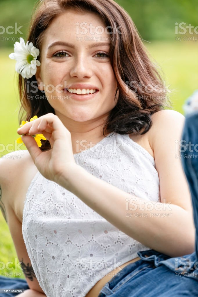 Eighteen Year Old Woman Enjoys Being Outdoors with Flowers stock photo