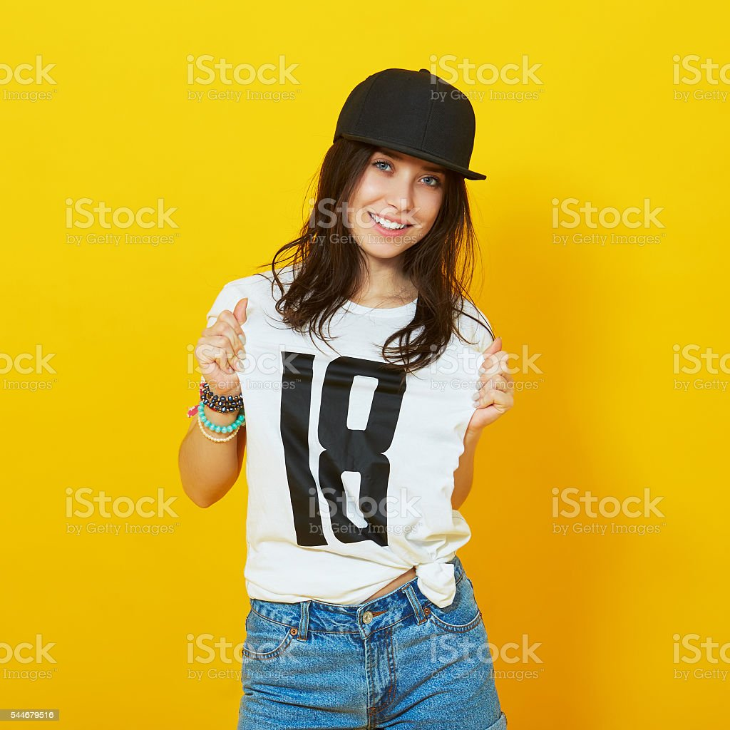 Eighteen years old teenage girl pointing to her t-shirt - foto de acervo