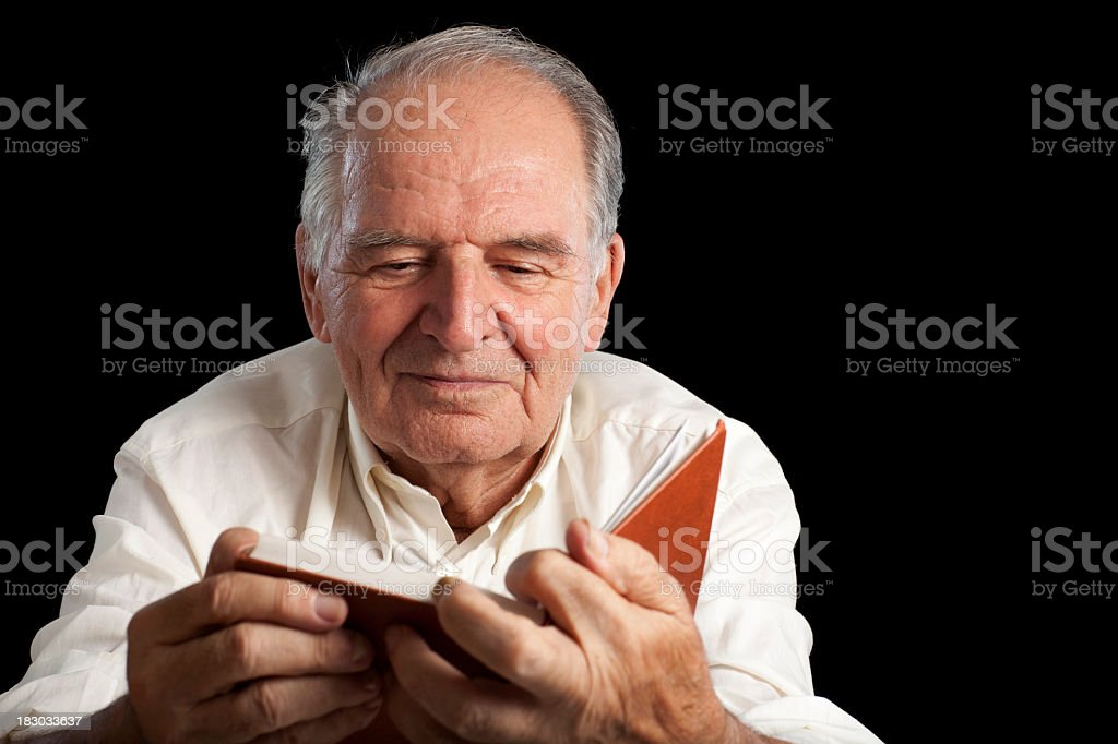 Eighty six years old man reading book without glasses. royalty-free stock photo