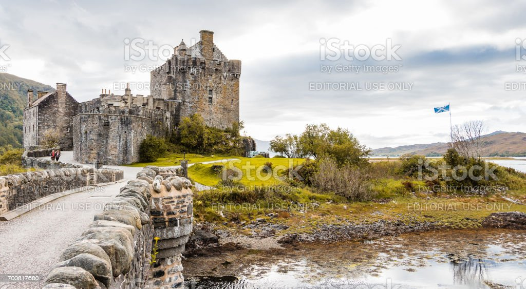 Eilean Donan castle panorama with Scottish flag stock photo
