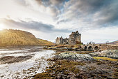 Dornie, Scotland, United Kingdom - December 29, 2015: Sunset over the beautiful and famous Eilean Donan Castle on small island in Loch Alsh in the Highland Region of Scotland at Sunset. Dornie, Scotland, United Kingdom