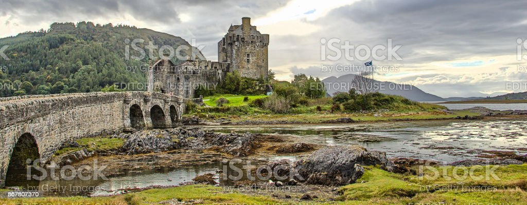 Eilean Donan castle with Scottish flag HDR stock photo