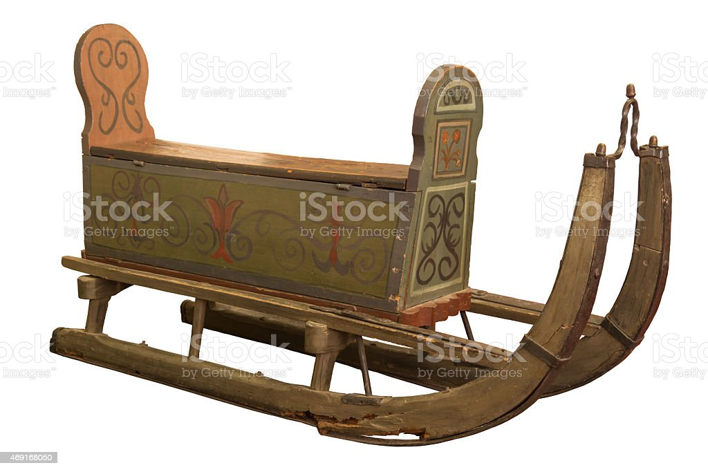 Ein alter Transportschlitten vor weißem Hintergrund stock photo
