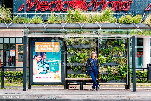Eindhoven, Netherlands- May 24, 2015: The green bus stop was created as part of a competition organized by the Municipality of Eindhoven back in 2009. The bus station was featured during 2009 Dutch Design Week