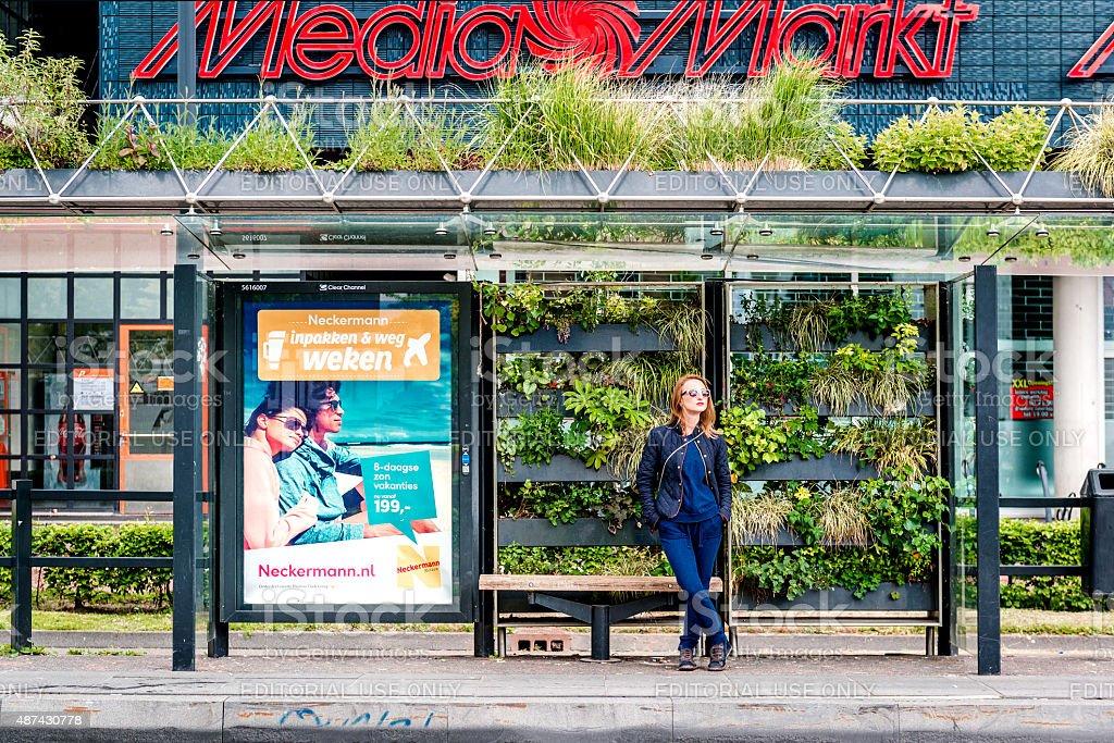 Eindhoven green bus stop stock photo
