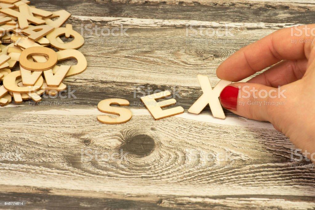 Eine Frau und das Wort sexo - foto de acervo
