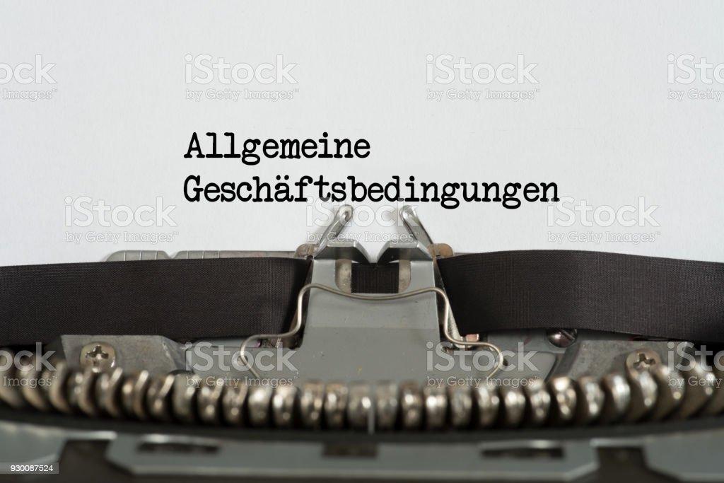 Eine Schreibmaschine, Papier Stück und Allgemeine Geschäftsbedingungen AGB foto