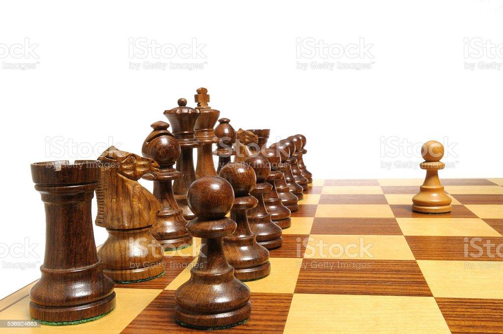 Einer gegen alle - Alle gegen einen - Schachfiguren 1 stock photo