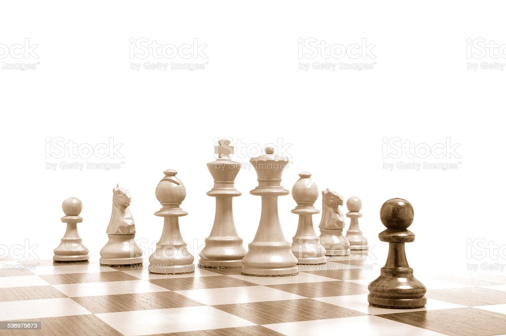 Einer gegen alle - Alle gegen einen - Schachfiguren 4 stock photo