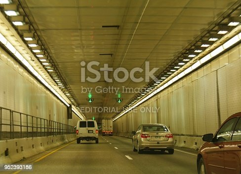 SUMMIT COUNTY, COLORADO—OCTOBER 2017: Cars drive through the Eisenhower Tunnel, also called the Eisenhower–Edwin C. Johnson Memorial Tunnel on Interstate 70 about 60 miles west of Denver.