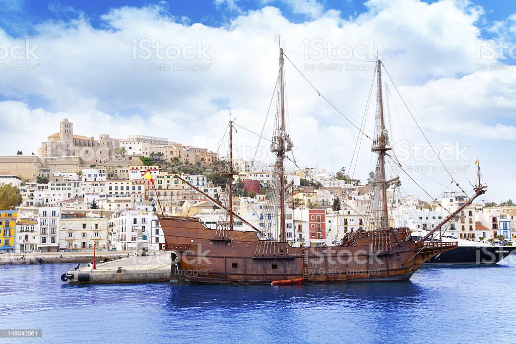 Eivissa ibiza town with old classic wooden boat stock photo