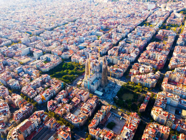 Eixample district, Sagrada Familia, Barcelona Aerial view of cityscape of Barcelona, Eixample district and Sagrada Familia barcelona spain stock pictures, royalty-free photos & images