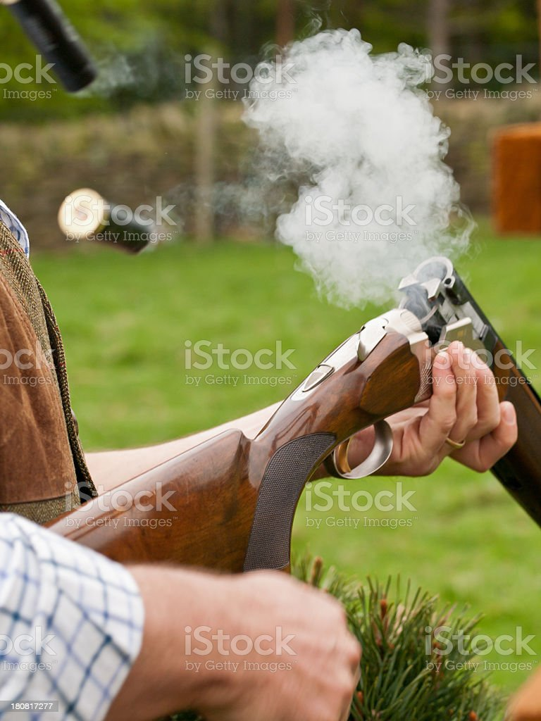 Ejection of a casing from a bullet stock photo