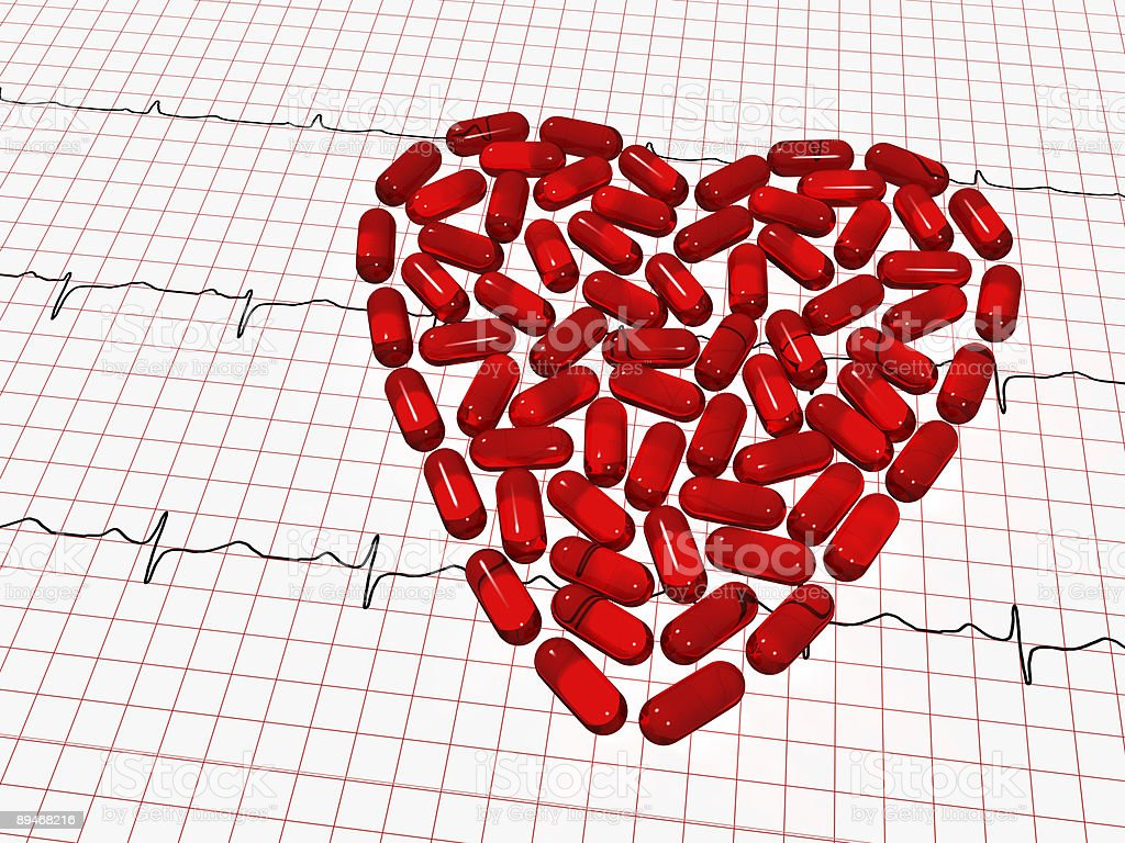 ekg paper and red tablets heart royalty-free stock photo