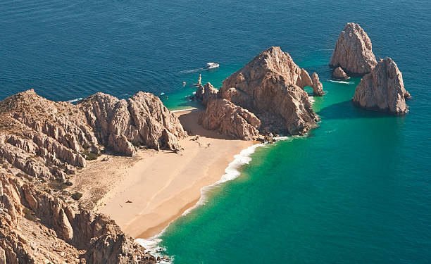 el arco and lover's beach aerial view - outcrop stock pictures, royalty-free photos & images