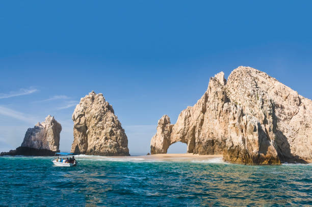 El Arco, at Land's End, Cabo San Lucas. Giant rocky outcrops featuring a natural arch, are one of the most famous natural attractions of Mexico. El Arco, at Land's End, Cabo San Lucas. Giant rocky outcrops featuring a natural arch, are one of the most famous natural attractions of Mexico. outcrop stock pictures, royalty-free photos & images
