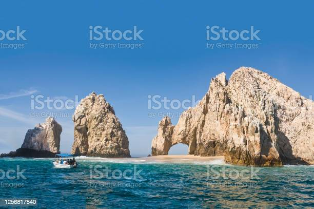 Photo of El Arco, at Land's End, Cabo San Lucas. Giant rocky outcrops featuring a natural arch, are one of the most famous natural attractions of Mexico.
