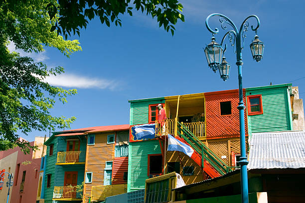 El Caminito in La Boca, Buenos Aires, Argentina Colorful houses on the Caminito in La Boca, the famous artistic community of Buenos Aires, Argentina, with the Argentinean flag and a blue lamppost. buenos aires stock pictures, royalty-free photos & images