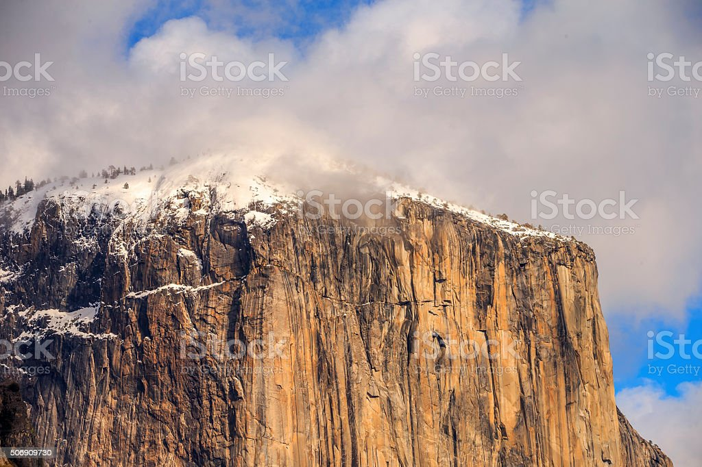 El Capitan covered by Snow and Fog in Yosemite, California stock photo