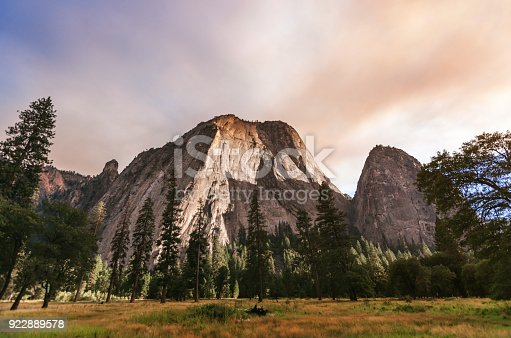 El Capitan in Yosemite. The tip of the mountain is colored by a wildfire smoke cloud