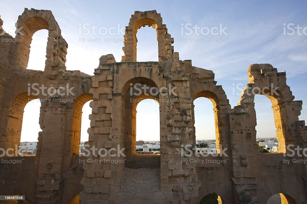 El Djem Amphitheatre arches with sunset stock photo