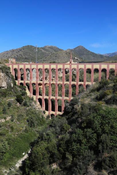 el águile aqueduct (the eagle aqueduct), nerja spain - pejft stock photos and pictures