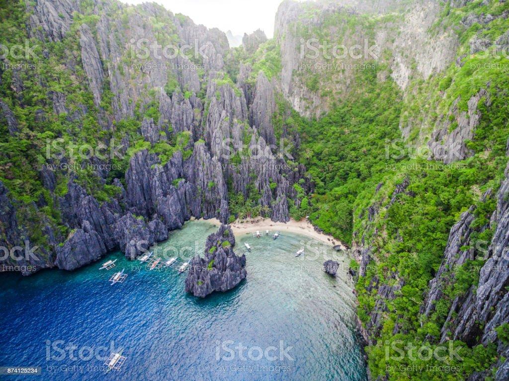 El Nido, Palawan, Philippines, Aerial View of Boats and Karst Scenery at Secret Lagoon Beach stock photo