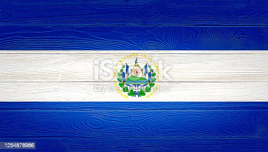 El Salvador flag painted on old wood plank background. Brushed wooden board texture. Wooden texture background flag of El Salvador