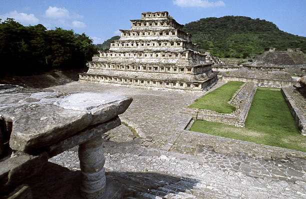 El Tahin - Pyramid of the Niches El Tahin - Pyramid of the Niches - may have been a giant calendar. Mesoamerican ball game field is on the right side. el tajin stock pictures, royalty-free photos & images