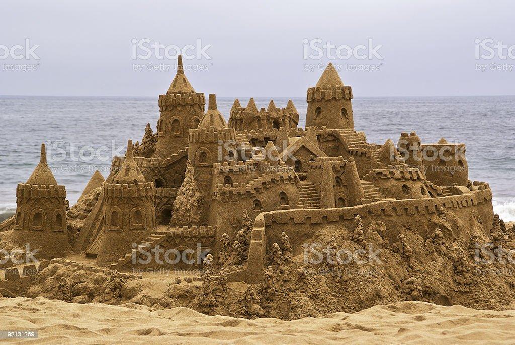 Elaborate sandcastle on the beach stock photo