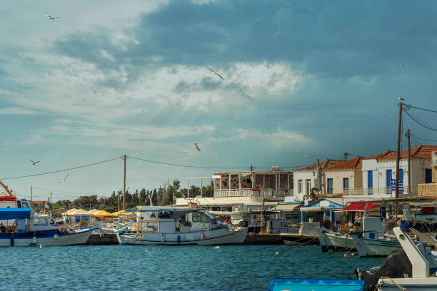 Elafonisos port in Greece aqgainst a dramatic sky. Famous touristic destination. stock photo