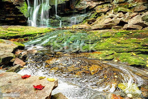 Elakala waterfall in Blackwater Falls State Park in West Virginia during autumn with red leaves foliage