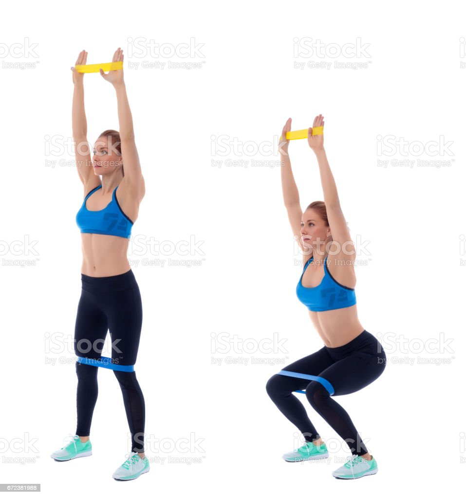Elastic band overhead squat stock photo