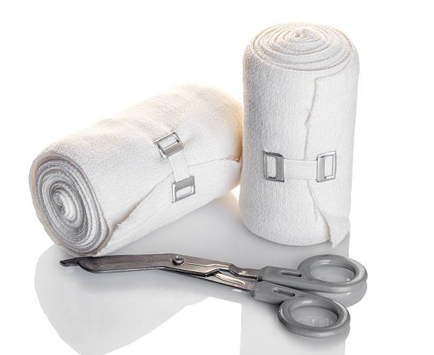 elastic bandage and scissors - medical dressing stock pictures, royalty-free photos & images